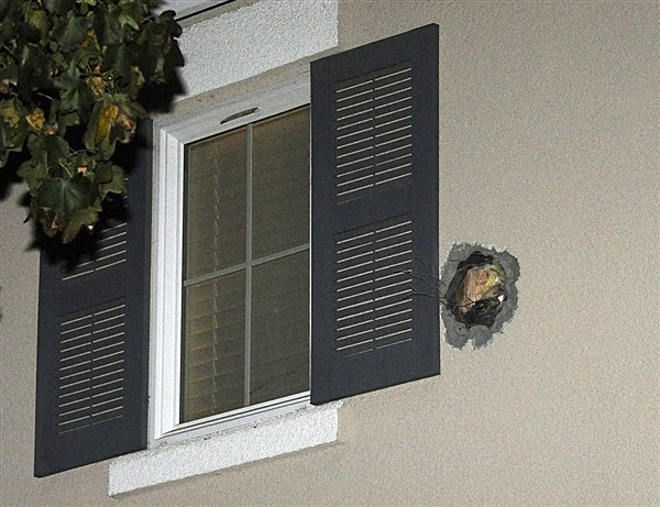 The exit hole from a misfired cannonball is seen after it traveled through a Dublin, Calif., home on Dec. 6.