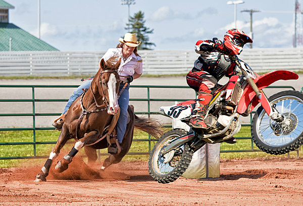 Barrel Racer Takes On Dirt Bike Rider At Rodeo