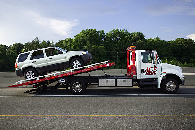 SUV on tow truck
